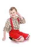 Muchacho en pantalones rojos Imagen de archivo