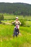 Muchacho en paseos de la bici Foto de archivo