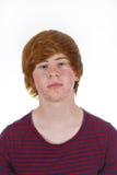muchacho en pubertad con el pelo rojo Foto de archivo