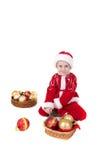 Muchacho en ropa de la Navidad con los juguetes Imagenes de archivo