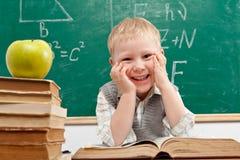 Muchacho en sala de clase Imagen de archivo libre de regalías