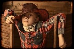 Muchacho en sombrero de vaquero Fotos de archivo