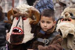 Muchacho en traje de mascarada tradicional fotografía de archivo libre de regalías
