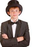 Muchacho en traje formal blanco y negro con el sombrero de copa Imágenes de archivo libres de regalías