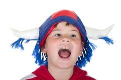 Muchacho en un casco del ventilador Fotos de archivo