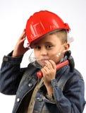 Muchacho en un casco rojo Fotos de archivo
