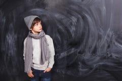 Muchacho en un fondo gris Foto de archivo