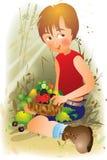 Muchacho en un jardín Foto de archivo libre de regalías