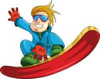 Muchacho en un snowboard Imágenes de archivo libres de regalías