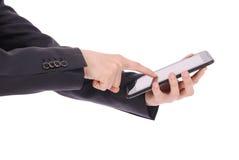 Muchacho en un traje que sienta y que sostiene una tableta que señala el finger Imágenes de archivo libres de regalías