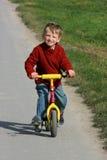 Muchacho en una bici Imagen de archivo libre de regalías