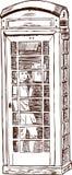 Muchacho en una cabina de teléfono Imagen de archivo