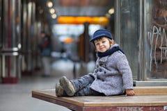 Muchacho en una estación de metro Foto de archivo libre de regalías