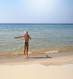 Muchacho en una playa Imagen de archivo libre de regalías