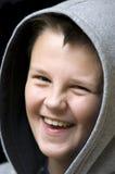 Muchacho encapuchado sonriente Foto de archivo libre de regalías