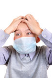 Muchacho enfermo en máscara de la gripe Imagen de archivo libre de regalías