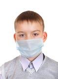 Muchacho enfermo en máscara de la gripe Foto de archivo libre de regalías