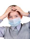 Muchacho enfermo en máscara de la gripe Fotografía de archivo libre de regalías