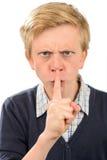 Muchacho enojado con el finger en los labios Fotografía de archivo libre de regalías