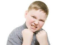 Muchacho enojado con los puños Fotos de archivo libres de regalías