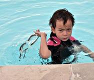 Muchacho enojado en piscina Imágenes de archivo libres de regalías