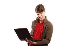 Muchacho enojado que mira el ordenador Imágenes de archivo libres de regalías