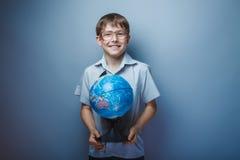 Muchacho europeo del adolescente del aspecto con los vidrios Fotografía de archivo libre de regalías