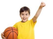 Muchacho feliz con baloncesto Fotos de archivo libres de regalías