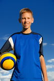 Muchacho feliz con el balón de fútbol Fotografía de archivo libre de regalías