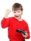 Muchacho feliz con el gamepad en manos Foto de archivo libre de regalías