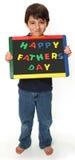 Muchacho feliz con la muestra feliz del día de padres fotografía de archivo