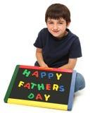 Muchacho feliz con la muestra feliz del día de padres fotografía de archivo libre de regalías