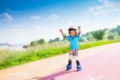 Muchacho feliz con las manos levantadas Imagen de archivo libre de regalías