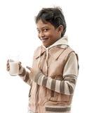 Muchacho feliz con leche Imagenes de archivo