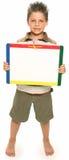 Muchacho feliz con Whiteboard fotografía de archivo