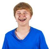 Muchacho feliz de risa lindo aislado en blanco Imagen de archivo
