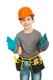 Muchacho feliz del cabrito que desgasta guantes grandes Imágenes de archivo libres de regalías