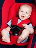 Muchacho feliz en asiento de coche Imágenes de archivo libres de regalías