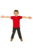 Muchacho feliz en camiseta roja en blanco Foto de archivo libre de regalías