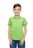 Muchacho feliz en camiseta verde del polo Imágenes de archivo libres de regalías