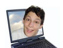 Muchacho feliz en computadora portátil Fotos de archivo