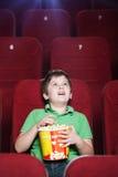 Muchacho feliz en el cine Foto de archivo libre de regalías