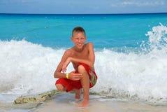 Muchacho feliz en la playa Fotografía de archivo libre de regalías