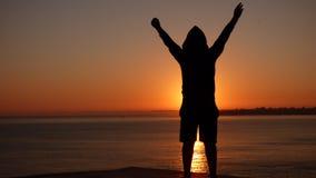 Muchacho feliz en la puesta del sol Imagenes de archivo