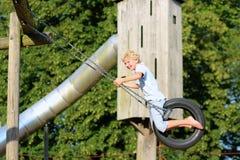 Muchacho feliz en patio en el parque Imagen de archivo libre de regalías