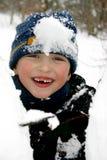 Muchacho feliz en un día de la nieve Imágenes de archivo libres de regalías