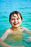 Muchacho feliz joven con el pelo marrón Imágenes de archivo libres de regalías