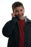 Muchacho feliz joven con el teléfono móvil Imagen de archivo