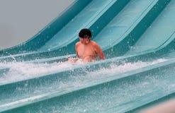 Muchacho feliz que cae en el agua Fotos de archivo libres de regalías