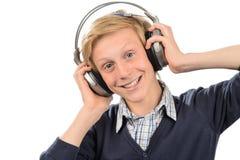 Muchacho feliz que escucha la música Fotos de archivo libres de regalías